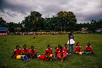 JAIPALGURI, INDIA- AUGUST 15:  Player and coach of the female football team, the Dooars XI,  Bhabani Munda, 24, and her team react as they watch a penalty shoot out, that they eventually lost, during a local football derby match on Independence day on August 15, 2013 in a village In Jalpaiguri district (the Kalchini tea estate is in this district) West Bengal. The Kalchini tea estate where Bhabani Munda lives is one of the most interior and backwards regions in north Bengal. The tea estates of North Bengal, including the Kalchini tea estate, were in news in 2007-08 for large-scale starvation deaths owing to malnutrition. Even today one person dies every day due to starvation in the north Bengal tea estates. In the last decade there have been 3500 deaths in these tea estates. (Photo by Daniel Berehulak for Time Magazine)