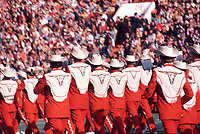 In this vintage 1970 photo The University of Texas Longhorn Band performs before the Texas' longhorn fans during a Southwest Conference game, with head coach Darrell K. Royal.