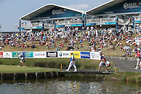 Leader Jaco Van Zyl (RSA) crosses the bridge to the 18th in front of the gallery during Round Three of the 2015 Alstom Open de France, played at Le Golf National, Saint-Quentin-En-Yvelines, Paris, France. /04/07/2015/. Picture: Golffile | David Lloyd<br /> <br /> All photos usage must carry mandatory copyright credit (© Golffile | David Lloyd)