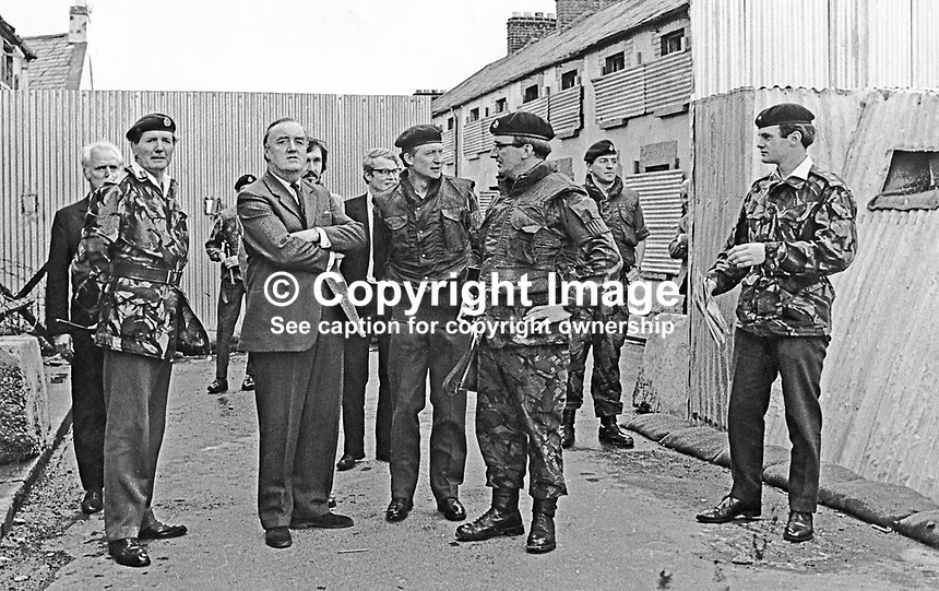 Secretary of State for N Ireland, William Whitelaw, visits British troops serving in Londonderry, N Ireland.  Also in the photo (on the left) is Major General Robert Ford. 1972081201WW1.<br />