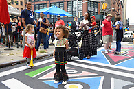 An animated girl having fun at the block party.