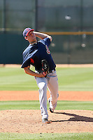 Nick Hagadone #59 of the Cleveland Indians pitches in a minor league spring training game against the Cincinnati Reds at the Indians minor league complex on March 27, 2011  in Goodyear, Arizona. .Photo by:  Bill Mitchell/Four Seam Images.