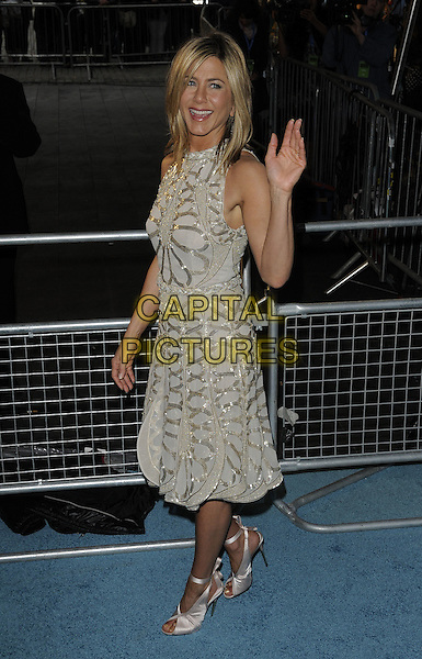 JENNIFER ANISTON.Horrible Bosses UK Premiere, BFI, London, England..20th July 2011.full length  length white cream dress sheer gold folds folded pleats pleated sleeveless braid braided belt sequins sequined ribbon ankle shoes peep toe hand waving side.CAP/CAN.©Can Nguyen/Capital Pictures.
