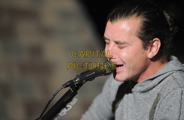 Gavin Rossdale.98.7FM Presents Bush  in an exclusive live performance at the 98.7FM Penthouse inside the Historic Hollywood Tower in Hollywood, California, USA..January 31st, 2012     .on stage in concert live gig performance performing music headshot portrait grey gray singing profile                                                                     .CAP/RKE/DVS.©DVS/RockinExposures/Capital Pictures.