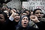 © Remi OCHLIK/IP3 - Tunis the 14 january 2011 - Thousands of tunisian demonstrators gather in front of the interior ministery yelling for president Ben Ali get out..Tunisia riots continued as President Zine El Abidine Ben Ali decided to dismiss his government following massive riots. The country's state news agency TAP says the president plans to call for new election in the next six months. Thousands of protestors took to the streets. The riots were sparked by high unemployment rates and a sagging economy as well as anger over government corruption. Tunisians enjoy little freedoms under President Zine El Abidine Ben Ali who has ruled a repressive regime for 23 years. Protestors ransacked buildings and threw rocks. Police used tear gas and gunshots to quell the crowd as protests got increasingly violent.