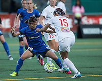 Seattle, WA - Saturday July 16, 2016: Nahomi Kawasumi, Jaelene Hinkle during a regular season National Women's Soccer League (NWSL) match between the Seattle Reign FC and the Western New York Flash at Memorial Stadium.
