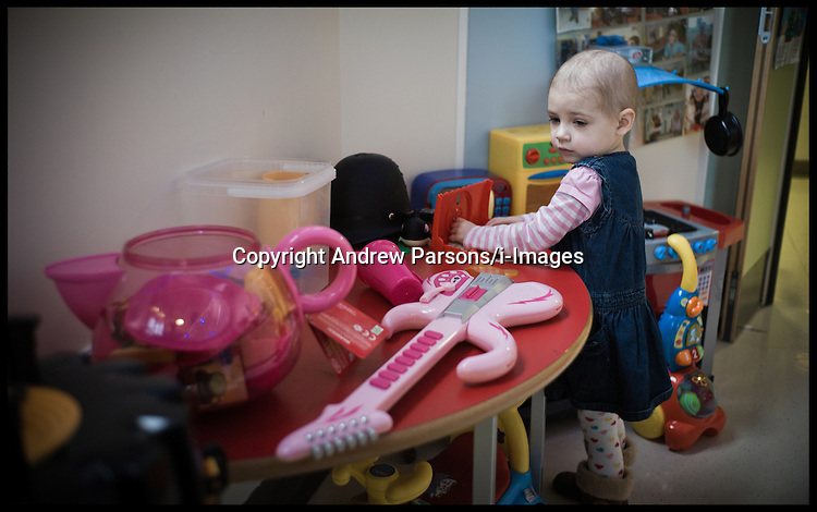 Yasmin plays in the Children's play room on the Cancer ward in Great Ormond Street with the Christmas Decorations up. Thieves have stolen Christmas presents for seriously ill children being treated at Great Ormond Street Hospital. Photo By Andrew Parsons / i-Images