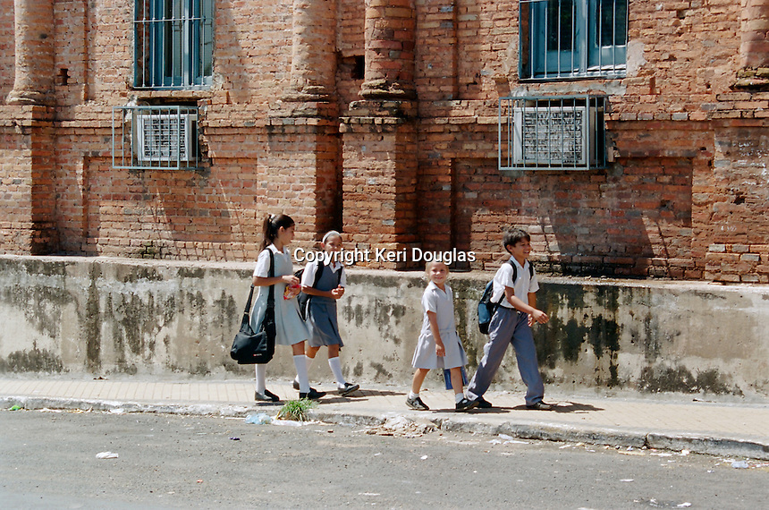 Young children from shanty town alongside Congressional Building going to afternoon school, Asuncion, Paraguay.