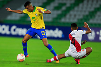 ARMENIA, COLOMBIA - JANUARY 19: Brazil's Reinier fights for the ball against Peru's Gianfranco Chavez during their CONMEBOL Pre-Olympic soccer game at Centenario Stadium on January 19, 2020 in Armenia, Colombia. (Photo by Daniel Munoz/VIEW press/Getty Images)