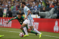 Seattle, WA - Tuesday June 14, 2016: Jhasmani Campos, Gonzalo Higuain<br />  during a Copa America Centenario Group D match between Argentina (ARG) and Bolivia (BOL) at CenturyLink Field.