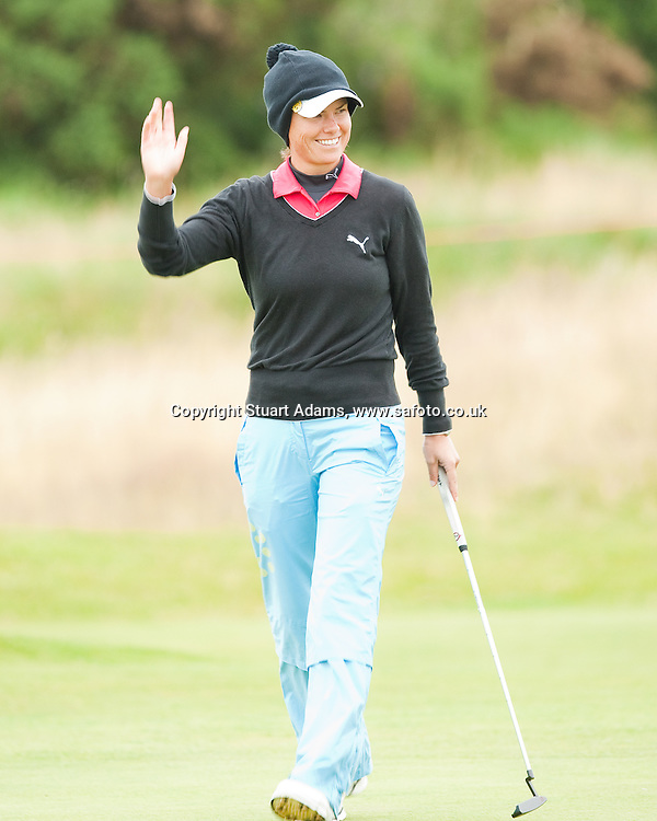 Lee-Anne Pace acknowledges the galleries who had stayed late into the day during the first round play of the  Ricoh Woman's British Open to be played over the Championship Links from 28th to 31st July 2011; Picture Stuart Adams, SAFOTO. www.safoto.co.uk; 28th July 2011