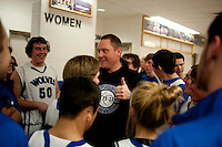 Grandview High School unified basketball head coach Cory Chandler (cq) congratulates his team after a victory in a game against Overland High School at Grandview High School in Aurora, Colorado, Wednesday, February 1, 2012. Unified sports teams, an outgrowth of the Special Olympics, are teams with both special needs and traditional high school students as players. The idea is that special needs kids shouldn't be separated and be allowed to participate in a competitive games as well at their schools...Photo by Matt Nager
