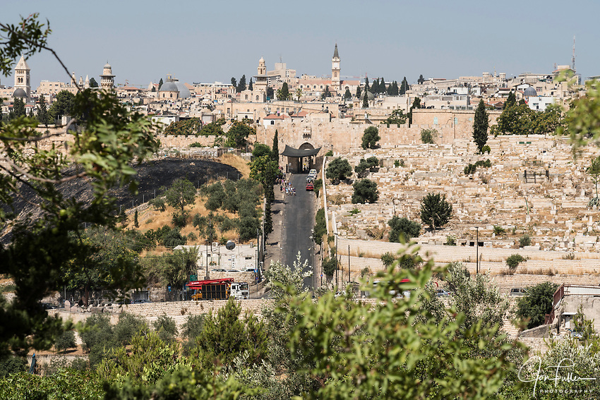 The Lions' Gate or St. Stephen's Gate into the Muslim Quarter in the Old City of Jerusalem.  At right is a Muslim cemetery outside the city walls.  The Old City of Jerusalem and its Walls is a UNESCO World Heritage Site.