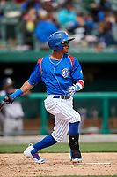 South Bend Cubs second baseman Yeiler Peguero (20) follows through on a swing during a game against the Kane County Cougars on May 3, 2017 at Four Winds Field in South Bend, Indiana.  South Bend defeated Kane County 6-2.  (Mike Janes/Four Seam Images)