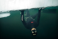 Terje Brandshaug up side down, freediving under the ice at Lutvann lake,outside Oslo, Norway. Photo: Fredrik Naumann/Felix Features