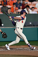 Shortstop Logan Davidson (8) of the Clemson Tigers bats in a game against the Charlotte 49ers on Monday, February 18, 2019, at Doug Kingsmore Stadium in Clemson, South Carolina. Clemson won, 7-6. (Tom Priddy/Four Seam Images)
