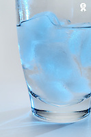 Ice cubes melting in glass, close-up (Licence this image exclusively with Getty: http://www.gettyimages.com/detail/sb10068346s-001 )