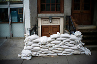 "NEW YORK, NY - AUGUST 4: A house entrance is blocked to prevent flooding at the South Street Seaport as city gets ready for tropical storm Isaias on August 4, 2020 in New York City. The Tri-State area ""New York, New Jersey and Connecticut"" is preparing for torrential rain, strong winds from Tropical storm Isaias. (Photo by Eduardo MunozAlvarez/VIEWpress)"