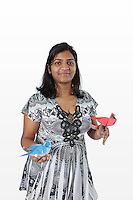 OrigamiUSA 2016 Convention at St. John's University, Queens, New York, USA. Nikki Chaudhary, Islip, New York. First timer at the OrigamiUSA 2016 Covention. Most complex model OUSA 2016 classes were attended by young males. Nikki was one of the few females who attended these classes and successfully folded complex models like the Cardinal by Robert Lang and the Autumn Bluejay by Seth Friedman which she is holding in the photo.