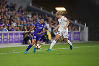Orlando, FL - Saturday March 24, 2018: Orlando Pride defender Poliana Barbosa Medeiros (19) cuts the ball on Utah Royals forward Elise Thorsnes (20) during a regular season National Women's Soccer League (NWSL) match between the Orlando Pride and the Utah Royals FC at Orlando City Stadium. The game ended in a 1-1 draw.