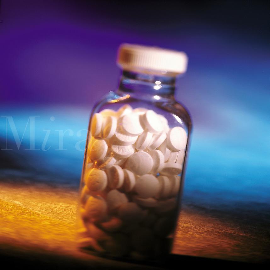 Bottle of aspirin.