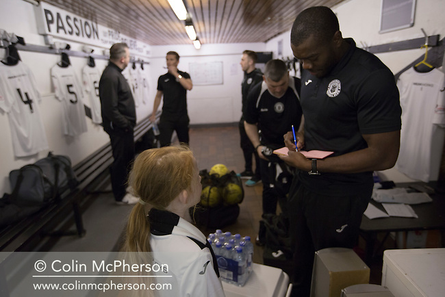 Edinburgh City defender Joe Mbu signs an autograph in the home dressing room prior to his team's SPFL2 match against Berwick Rangers at Meadowbank. Despite taking the lead in the 66th minute through Ousman See's goal, City lost the game 2-1, watched by a crowd of 410 and remained without a point at the foot of the table after four League games.