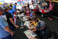 Oct 14, 2016; Ennis, TX, USA; NHRA fans get autographs at the Toyota Pit Pass display during qualifying for the Fall Nationals at Texas Motorplex. Mandatory Credit: Mark J. Rebilas-USA TODAY Sports
