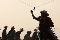 """Cavaleiros disputam corridas   durante as homenagens a São Benedito, chamado de santo preto, durante uma das mais importantes procissões religiosas do Pará que acontece amanhã.<br /> Bragança, Pará, Brasil.<br /> Foto Paulo Santos<br /> 25/12/2011<br /> <br /> A origem<br /> <br /> A Marujada,  em Bragança,  teve inicio em 1798 quando os senhores brancos atendendo ao pedido de seus escravos, permitiram a organização de uma Irmandade e a primeira festa em louvor a São Benedito. Em sinal de reconhecimento, os negros foram dançar de casa em casa para agradecer a seus benfeitores.<br /> <br /> A Marujada é constituída na maioria por mulheres, cabendo lhes a direção e a organização. Não há número limitado de marujas, nem papéis a desempenhar. Nem uma só palavra é articulada, falada ou cantada como auto ou como argumentação. Não há dramatização de qualquer feito marítimo. A Marujada é caracterizada pela dança, cujo ritmo principal é o retumbão. A organização e a disciplina são exercidas por uma """"capitoa"""" e uma """"sub-capitoa"""". É a """"capitoa"""" quem escolhe a sua substituta, nomeando a """"sub-capitoa"""", que somente assumirá o bastão de direção por morte ou renúncia daquela.<br /> <br /> http://www.tracuateua.web44.net/braga.html<br /> <br /> http://www.cdpara.pa.gov.br/marujada.php"""