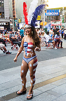 New York,, NY 29 August 2015 Desnudos in Times Square - Topless women, with body paint, offer to pose with tourists for photos in exchange for a tip. New York City Mayor Bill de Blasio has designated a Task Force and says he may consider eliminating the pedestrian mall and returning the streets to traffic. Toplessness in New York became legal in New York State in 1993
