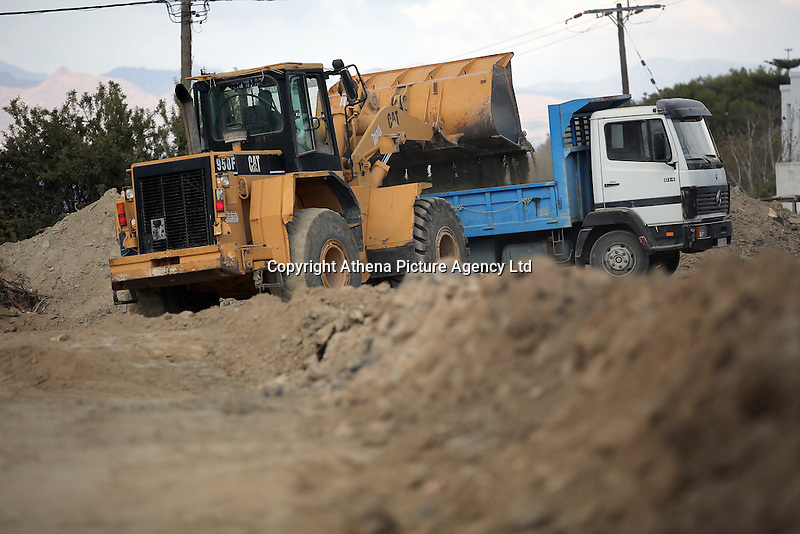 Pictured: A digger loads soil to a tipper lorry at the second site in Kos, Greece. Thursday 13 October 2016<br />Re: Police teams led by South Yorkshire Police are searching for missing toddler Ben Needham on the Greek island of Kos.<br />Ben, from Sheffield, was 21 months old when he disappeared on 24 July 1991 during a family holiday.<br />Digging has begun at a new site after a fresh line of inquiry suggested he could have been crushed by a digger.