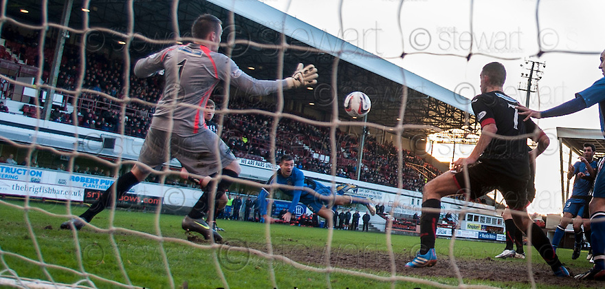 Stranraer's Steven Bell heads the ball past Pars keeper Ryan Scully to score their first goal.
