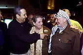Prime Minister Ehud Barak of Israel, left, United States Secretary of State Madeleine Albright, center, and Palestinian Authority Chairman Yasser Arafat, left, greet each other at dinner at Camp David in Thurmont, Maryland on Thursday evening, July 27,2000..Mandatory Credit: White House via CNP