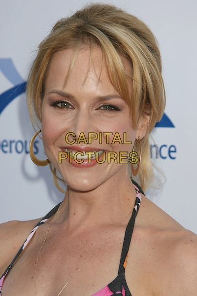 JULIE BENZ.7th Annual Comedy For A Cure benefiting The Tuberous Sclerosis Alliance held at the Avalon, Hollywood, California, USA..April 6th, 2008.headshot portrait gold hoop earrings halterneck .CAP/ADM/RE.©Russ Elliot/AdMedia/Capital Pictures.