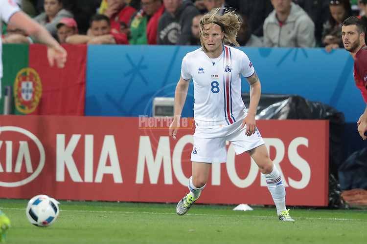 Birkir Bjarnason reacts with his team mates after his goal at the football match Portugal vs Iceland at the UEFA EURO 2016 FRANCE at Saint-Etienne, on June 14, 2016.