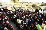 ZANZUR, Libya Sunday 4th September 2011:..Waiting for a food truck to arrive. ..Ayman Oghanna