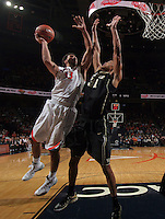 Virginia forward Anthony Gill (13) shoots next to Wake Forest center Andre Washington (31) during the game Wednesday Jan. 08, 2014 in Charlottesville, Va. Virginia defeated Wake Forest 74-51.