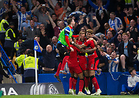 Huddersfield Town's Laurent Depoitre (centre)celebrates with team mates after scoring the opening goal <br /> <br /> Photographer Craig Mercer/CameraSport<br /> <br /> The Premier League - Chelsea v Huddersfield Town - Wednesday 9th May 2018 - Stamford Bridge - London<br /> <br /> World Copyright &copy; 2018 CameraSport. All rights reserved. 43 Linden Ave. Countesthorpe. Leicester. England. LE8 5PG - Tel: +44 (0) 116 277 4147 - admin@camerasport.com - www.camerasport.com