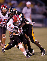 06 September 2008: Missouri safety Justin Garrett #8 tackles Southeast Missouri State wide receiver Michael Williamson #84 during first half action at Memorial Stadium in Columbia, Missouri.