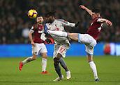 4th February 2019, London Stadium, London, England; EPL Premier League football, West Ham United versus Liverpool; Declan Rice of West Ham United challenges Divock Origi of Liverpool