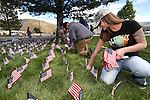Ruby Herman, members of the Western Nevada College Veterans Resource Center and other volunteers plant thousands of American flags at WNC, in Carson City, Nev. on Friday, May 6, 2016. The flags represent the more than 8,000 veterans who commit suicide each year.   <br /> Photo by Cathleen Allison/Nevada Photo Source