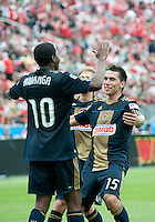Philadelphia Union forward Danny Mwanga #10 celebrates his goal with Philadelphia Union midfielder/defender Gabriel Farfan #15 during an MLS game between the Philadelphia Union and the Toronto FC at BMO Field in Toronto on May 28, 2011..The Philadelphia Union won 6-2..