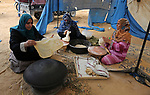 Palestinian women prepare traditional bread during a heritage festival at the Israel-Gaza border, in Khan Younis in the southern Gaza Strip on October 10, 2018. Photo by Ashraf Amra
