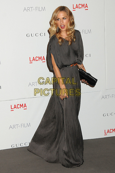 Rachel Zoe.The Inaugural Art and Film Gala held at LACMA in Los Angeles, California, USA..November 5th, 2011.full length dress  grey gray wet damp hem belt brown belt black clutch bag .CAP/ADM/BP.©Byron Purvis/AdMedia/Capital Pictures.