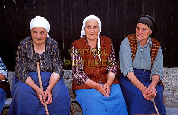 Three old ladies sitting on bench, Bansko, Bulgaria