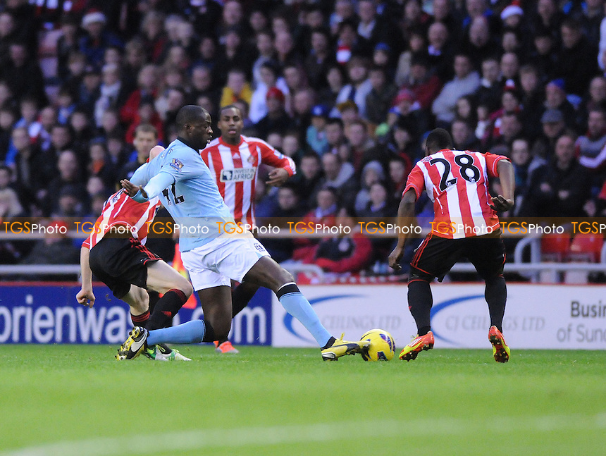 Manchester City midfielder Yaya Toure battling with Sunderland players - Sunderland vs Manchester City - Barclays Premier League Football at The Stadium of Light, Sunderland, Tyne & Wear - 26/12/12 - MANDATORY CREDIT: Steven White/TGSPHOTO - Self billing applies where appropriate - 0845 094 6026 - contact@tgsphoto.co.uk - NO UNPAID USE.