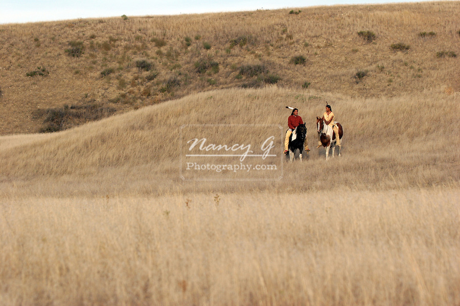 Two Native American Indians on horseback on the Praire of South Dakota