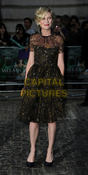 Kirsten Dunst (wearing new fashion label Honor's spring 2012 collection).UK Premiere of 'Melancholia' at the Curzon, Mayfair, London, England..September 28th 2011.full length organza paisley printed dress gold woven weave sheer black brown.CAP/CAS.©Bob Cass/Capital Pictures.