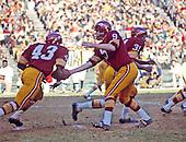 Washington Redskins quarterback Sonny Jurgensen (9) hands off to running back Larry Brown (43) during a game against the Atlanta Falcons at RFK Stadium in Washington, D.C. on Sunday, November 23, 1969.  The Redskins won the game 27 - 20.  Running back Charlie Harraway (31) leads the blocking..Credit: Arnie Sachs / CNP