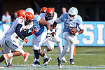 24 October 2015: UNC's Marquise Williams (12) is chased by Virginia's Quin Blanding (3). The University of North Carolina Tar Heels hosted the University of Virginia Cavaliers at Kenan Memorial Stadium in Chapel Hill, North Carolina in a 2015 NCAA Division I College Football game. UNC won the game 26-13.