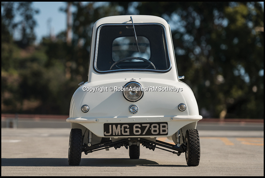 BNPS.co.uk (01202 558833)<br /> Pic: RobinAdams/RMSothebys/BNPS<br /> <br /> The smallest production car ever made has emerged for a rather large sum of £90,000 - 450 times what it first sold for. <br /> <br /> The dinky Peel P50 microcar is about the same size as the average mobility scooter - measuring only 4ft 5ins long and 3ft 3ins wide and tall. <br /> <br /> Isle of Man-based manufacturer Peel Engineering Company only sold 50 P50s for £199 each between 1962 and 1965. <br /> <br /> The Peel will be sold in Monterey, California, on August 18.